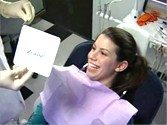 A woman enjoying the results of her Zoom Whitening