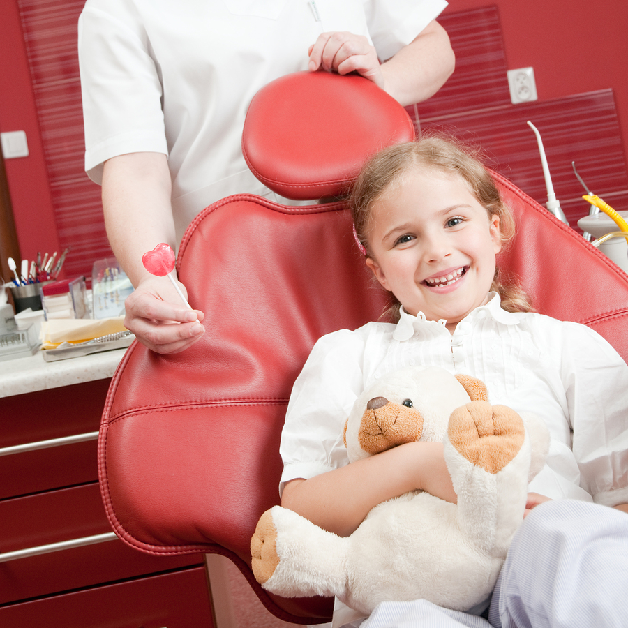 Happy girl in dental chair