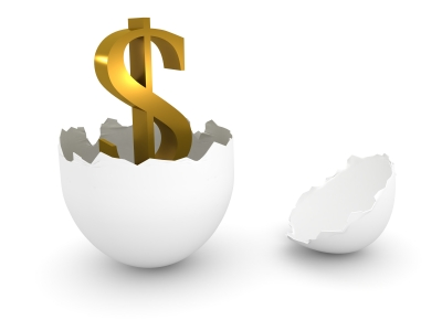 dollar sign hatching from an egg